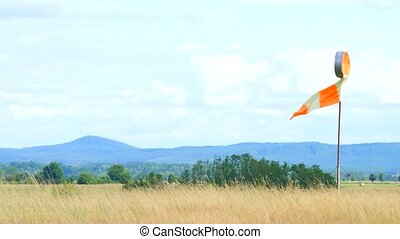 Wind sock fly. Summer hot day on privat sporty airport with...