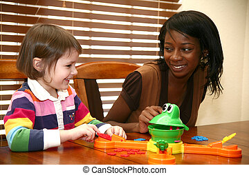 Baby Sitter - Beautiful african american woman playing games...