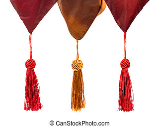 Textile and tassels isolated on white background