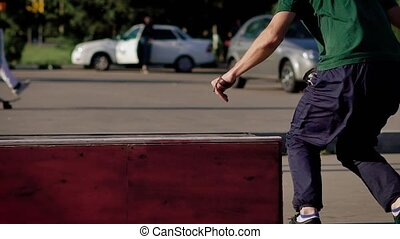 Skillful skateboarder performing stunt. He jumps on top of...