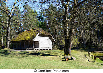 Old wooden house at Ethnographic open air village -...