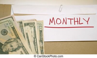 Monthly budget concept - USD bills on monthly budget cash...