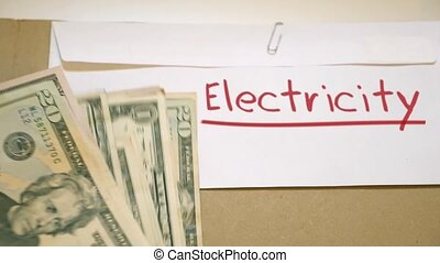 Paying electricity bill - USD bills onelectricity bills...