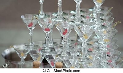 Pyramid of glasses with champagne outdoors