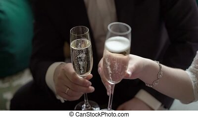 Young couple clinking glasses of champagne