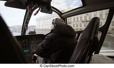 Pilot in helicopter indoors shot
