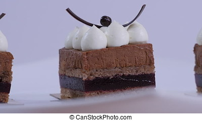 A chocolate cakes on white plate with whipping cream....
