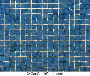 blue mosaic tiles on a wall...