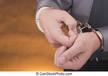 Arrest handcuffs - Arrested removes the handcuffs with a...