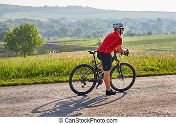 Ecotourism in Europe. Bicycle race in the country. Bicyclist...
