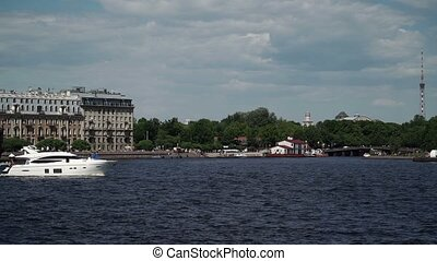 Luxury yacht in a city river at sunny day