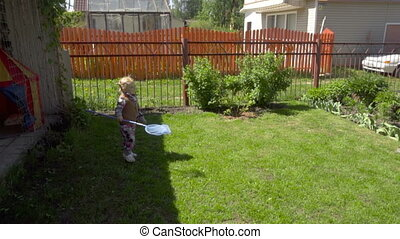 Girl catches soap bubbles - The girl is catching soap...