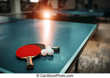 Ping pong table, rackets and balls in a sport hall - Ping...