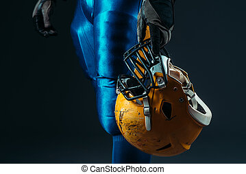 Male person in uniform with football helmet - Muscular male...