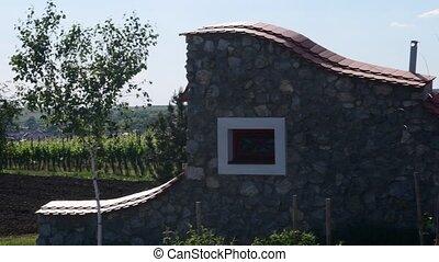 Panoramic view on wine cellar and vineyard.