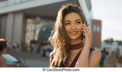Brunette Girl Talking by Phone - Close up shot of brunette...