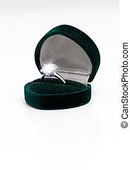 Wedding ring with diamond on white.