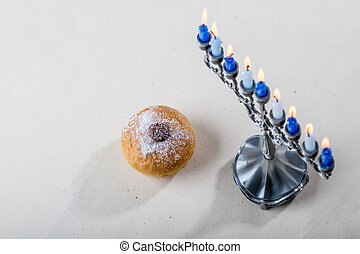 Jewish holiday of Hanukkah, hanukkah menorah and sufganiyah...