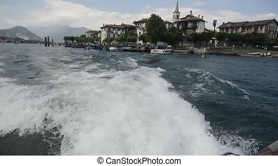 Travel with motor boat on Lago di Maggiore lake near Stresa...