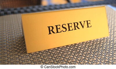 The plate is reserved on the restaurant table.