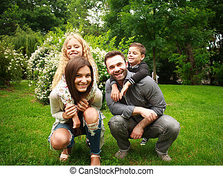 Portrait of a happy smiling family in city park