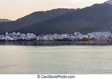Beautiful view on houses of seacoast at sunset in Greece,...