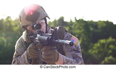 An Armed soldier takes aim.