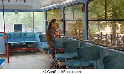 A beautiful girl with sad eyes rides in the tram. - A...
