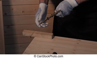 Senior carpenter working with vise - Senior carpenter...