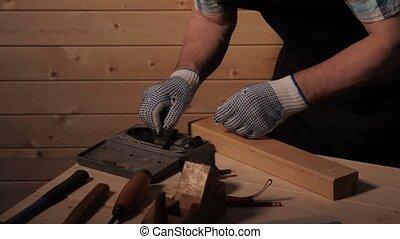 Senior carpenter preparing to work - Senior carpenter...
