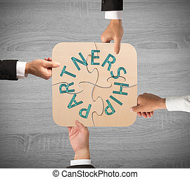 Business partnership puzzle - Concept of partnership with...