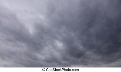 Time lapse of storm and rain gray clouds moving fast - Storm...