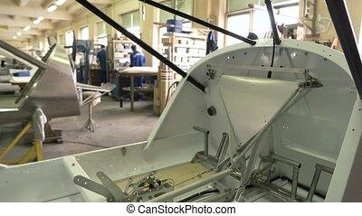 Airplane part in workshop.