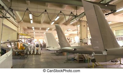 Inside aircraft workshop. Tails of airplanes. Aviation...