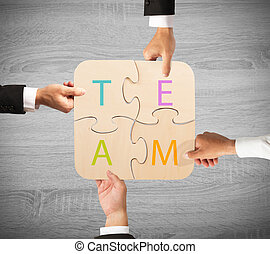 Business teamwork puzzle - Concept of team that works...