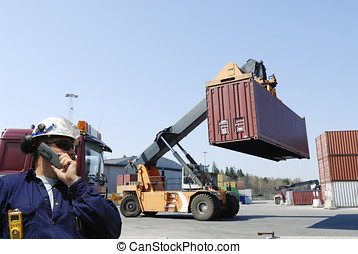 worker, port and containers - port worker directing trucks...