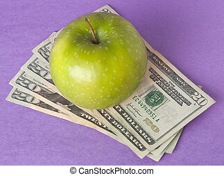 Cost of Education Health Care or Food - A green apple sits...