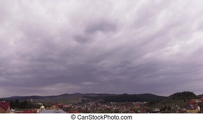Cloudy morning in small village. Panorama shooting in time lapse