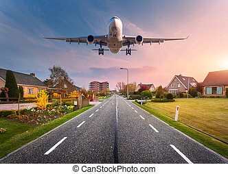 Beautiful cityscape with passenger airplane is flying in the...
