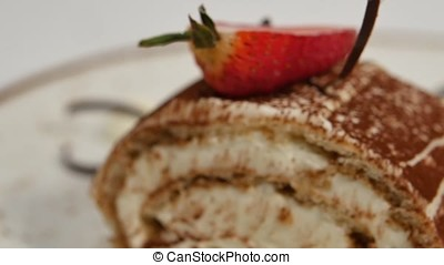 Strawberry cake. Strawberry short cake. Piece of creamy chocolate cake on heart shaped plate, topped with heart shaped strawberry. Crape cake with strawberry topping