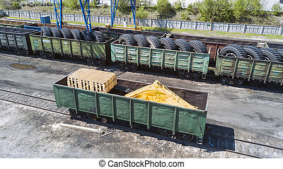 Freight trains on city cargo terminal - Loading of...
