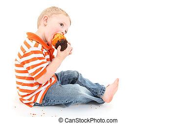 Cupcake Boy - Adorable 2 year old boy eating orange icing...