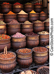 Spices - A spice vendors display, powdered spices in large...