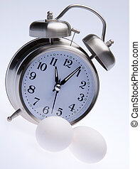 Clock with eggs works for Easter, Diet, Health and Time themes.