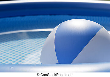 Beach ball floating in a swimming pool