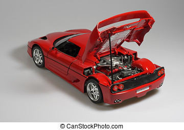 Red sport car miniature showing motor mini studio photo