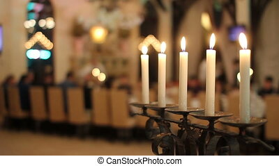 Candelstick with candles near the table - Close-up beautiful...