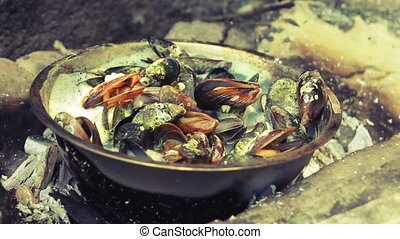 Mussels cooked on a sea beach - Mussels cooked in a large...