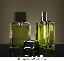 Green fragrance bottles with reflections on dark background....