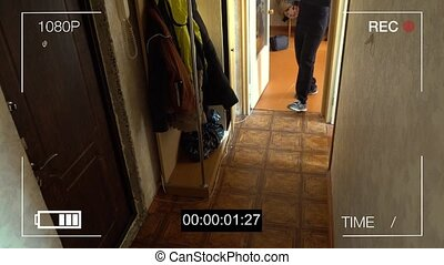 surveillance camera caught the robber in a mask with a...